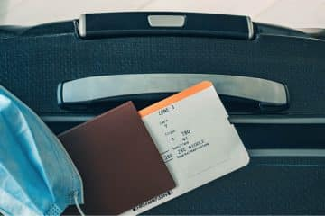 managing business travel risk with machine learning packed bags and mask image
